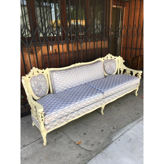 Beautiful vintage sofa with carved in design, the upholstery is in good condition.