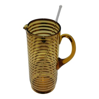 Mid-Century Modern Drinks Pitcher With Stirrer Amber Glass With Gold Bands For Sale