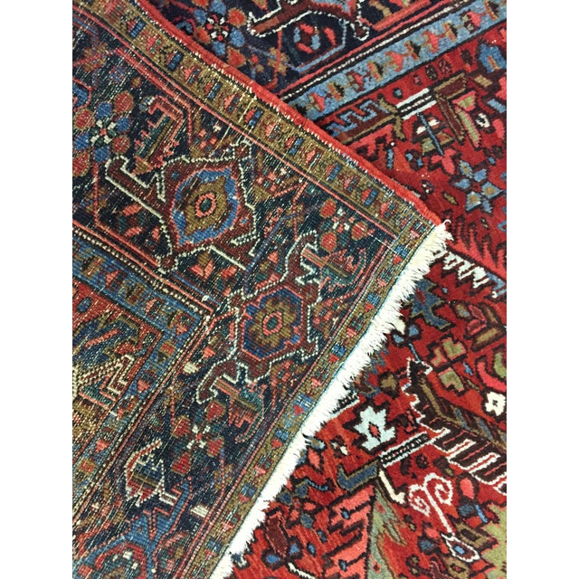 Vintage handwoven wool Persian heriz rug with a traditional design. Color: red/blue/ivory/green