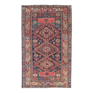Antique Kazak Rug With Geometric Medallions and Indigo Background For Sale