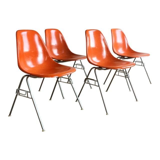 1960s Vintage Herman Miller Eames Orange Fiberglass Shell Chairs - Set of 4 For Sale