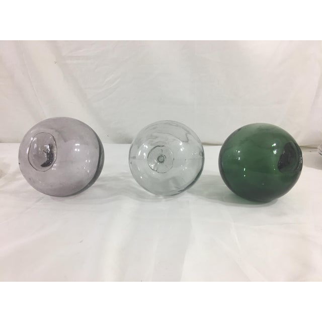 These three glass globes in light purple, dark green and light gray are fabulous accent pieces--perfect for displaying in...
