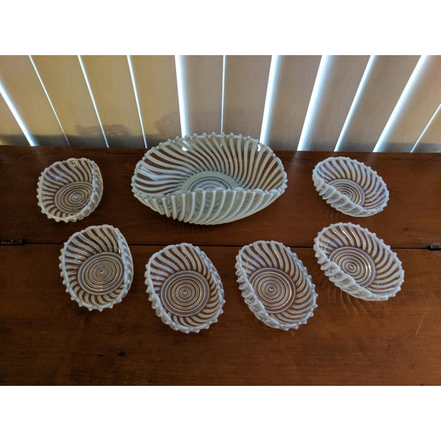 Set of 7 antique pressed opalescent bowls -- one oblong serving bowl with 6 individual serving bowls. Clear glass molded...