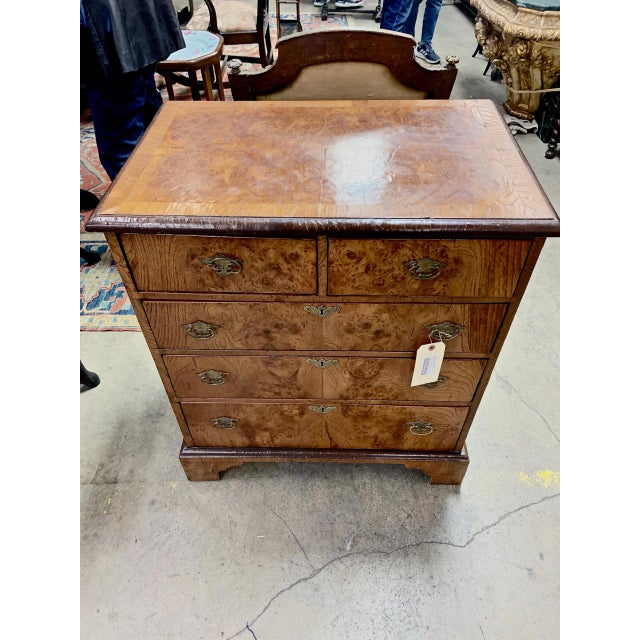 This is a charming late 19th/early 20th c. English George II-Style Bachelors Chest. This chest is a very faithful...
