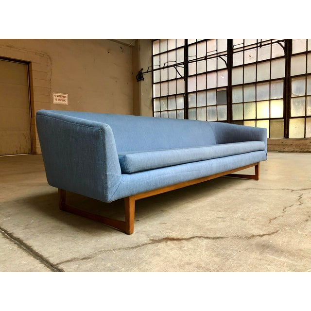The simple, clean lines of this vintage mid-century Danish style sofa are to die for! The smoothly curved seating form...