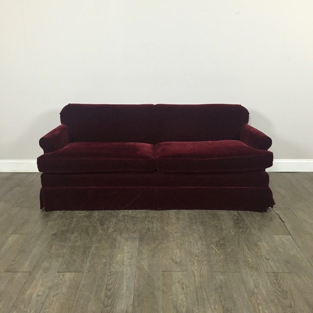 This unique piece is made of a red mohair material and is in excellent condition.