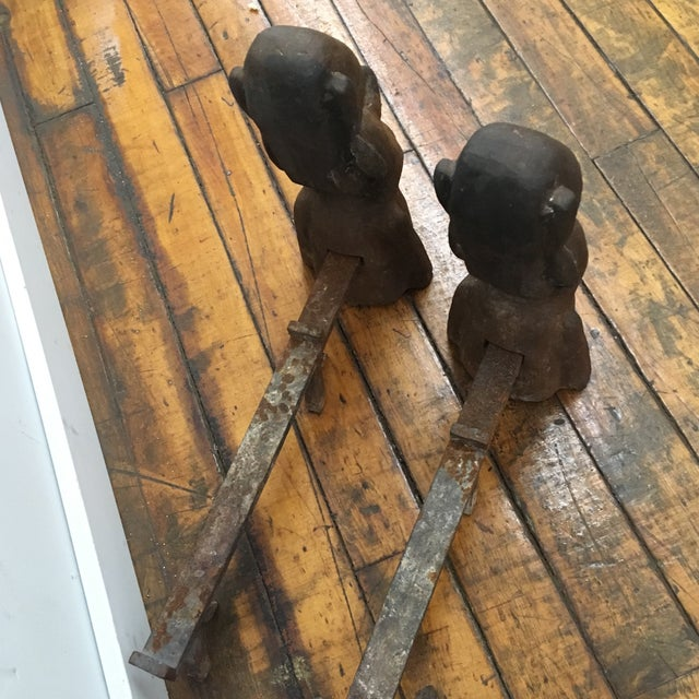 Terrific pair of caste iron andirons in homage to Easter island.
