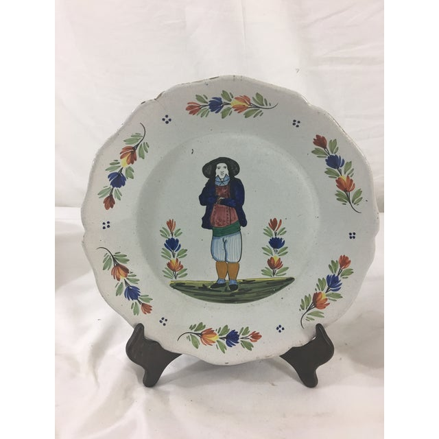 This set of three Quimper plates date from the late 1800's--between 1860 and 1890. They each feature a traditional man in...