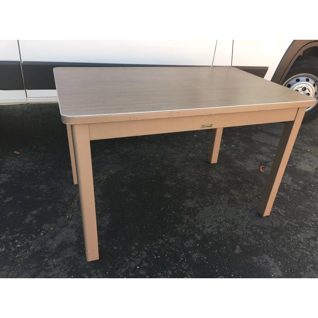 Beautiful McDowell and Craig vintage petite desk table. Easy to fit in most places hard to find size. Made in the 1960s.