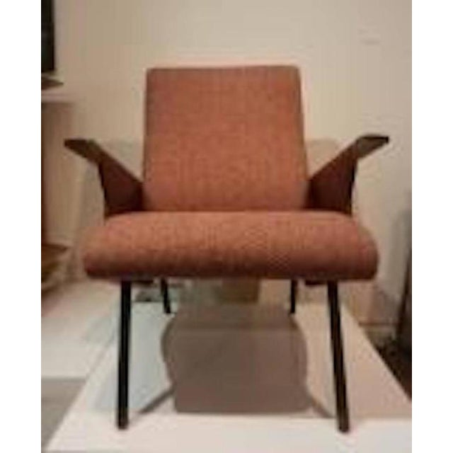 Rare single Mid-Century club chair, model D72, featuring a tight seat and back. The club also features splayed black...