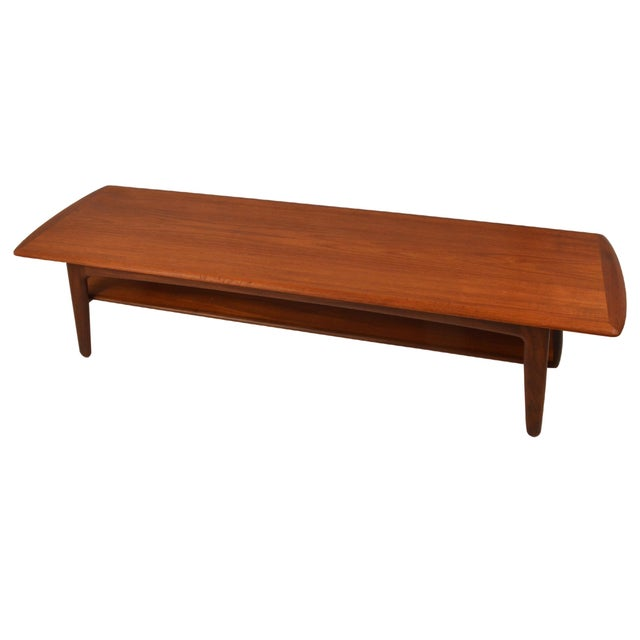 Stunning teak coffee table by Svend A. Madsen. Made in Denmark. Stamped underneath. The top has been refinished and it is...