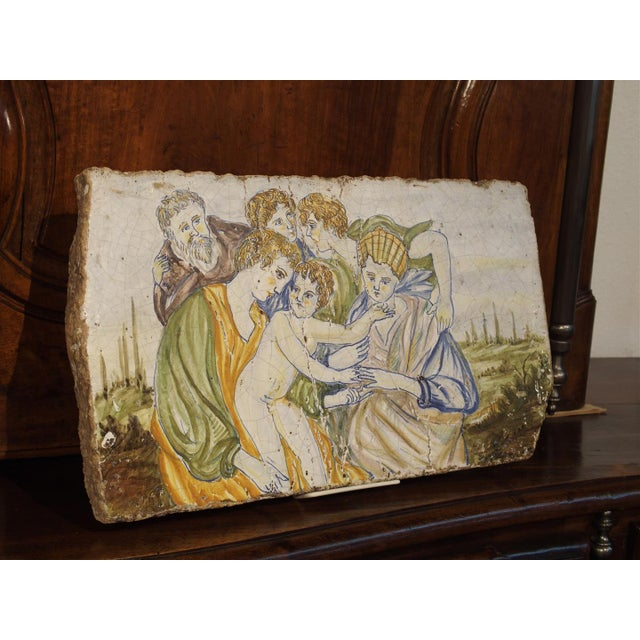 This impressive and very thick majolica or maiolica tile is from Italy and has hand painted scenes known as istoriato...