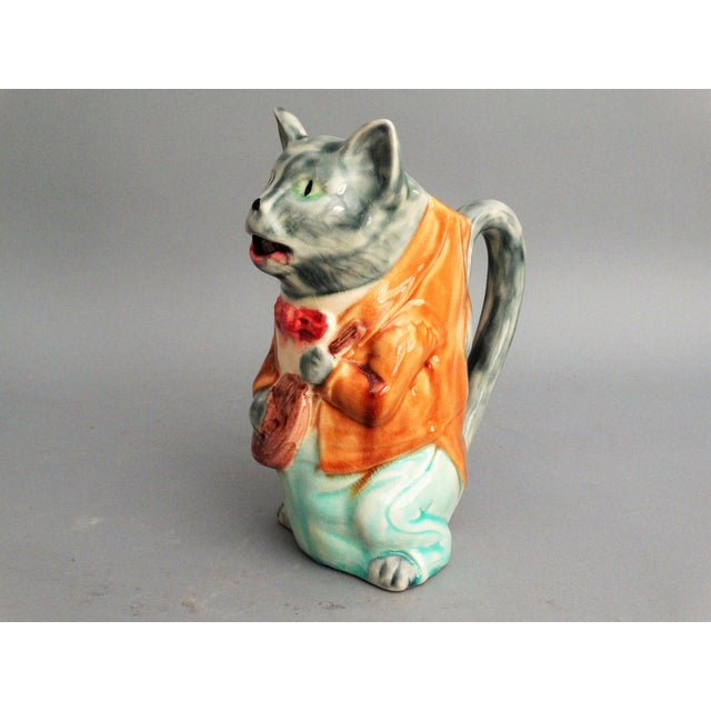 Ooh la la! 19th-century French Orchies majolica pitcher of a green eyed cat dressed in a jacket and bow tie holding a...