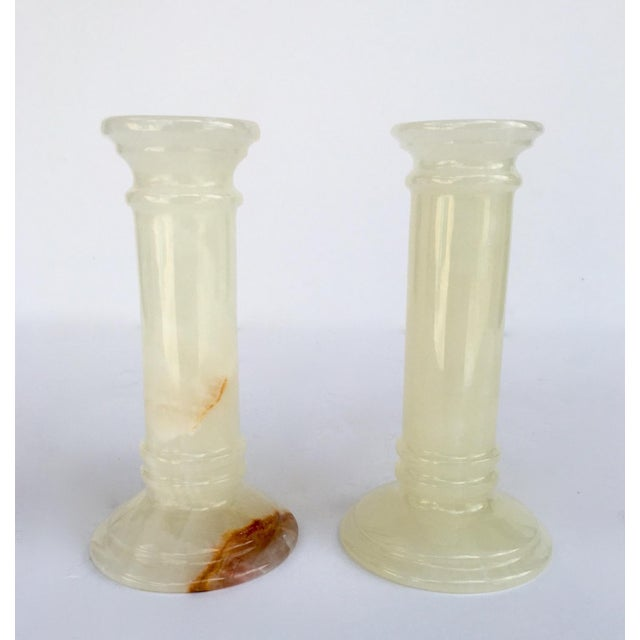 c1980s; is this pair of polished, onyx doric columned candle holders, made in Pakistan. One image of underside indicates,...
