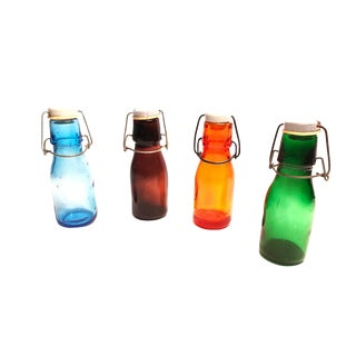 Vintage Mid-Century Colorful Bottles With White Ceramic Flip Top Lids - Set of 4