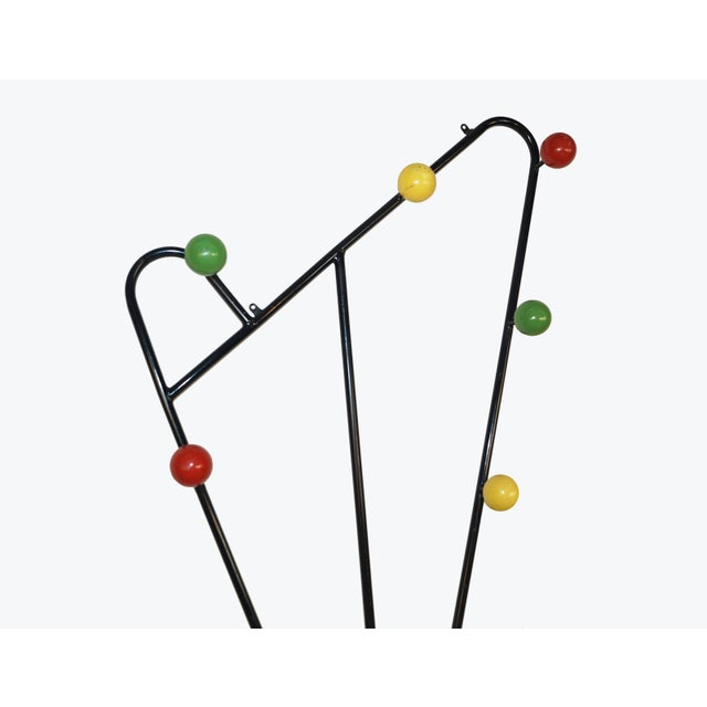 A modernist french wall mounted coat rack attributed to Roger Feraud.