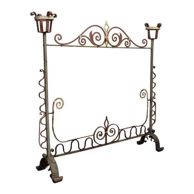 Large wrought iron fire screen with a bit of rust. No screen is included.