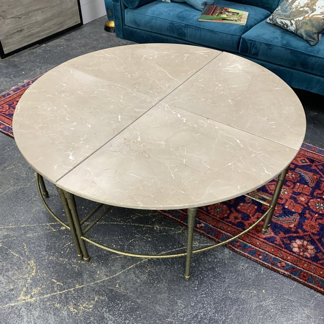 Gorgeous Grace Round marble coffee table with antique brass base Item separates into four sections. (Pie style). Muted...