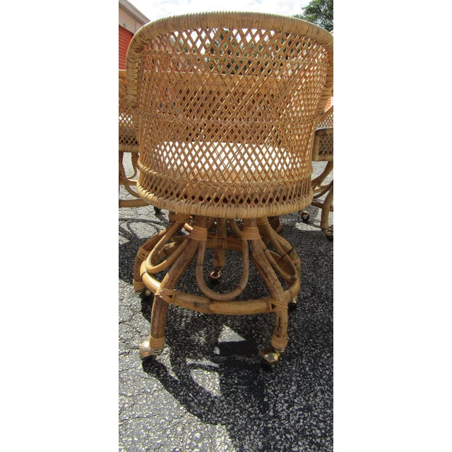 Woven rattan and bent bamboo table and chair set., vintage. The table top has a great swirl design and is topped with a 48...