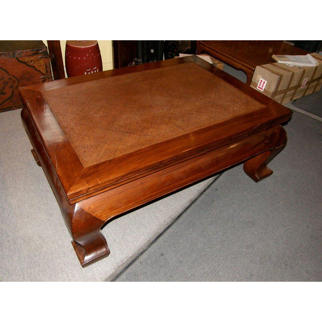 Chinese 19th century chow leg elmwood coffee table with woven bamboo top.