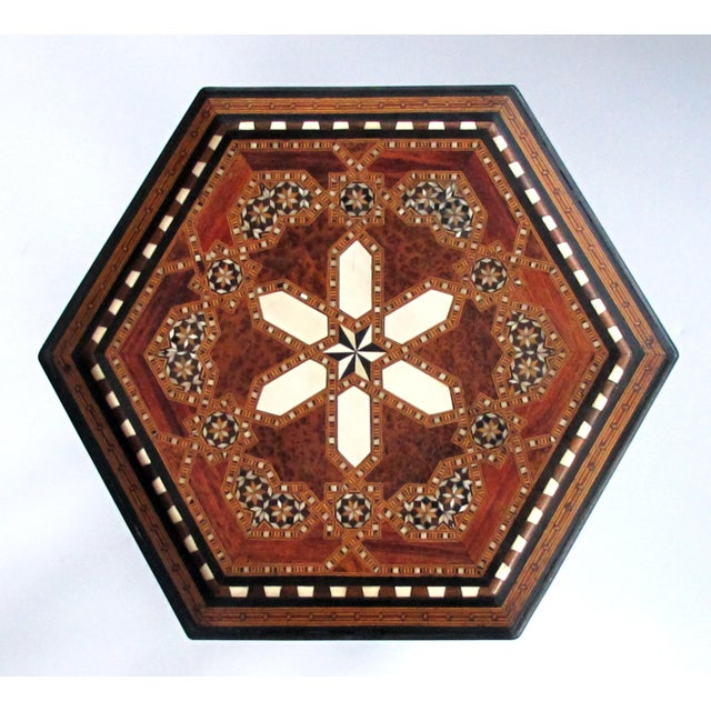 The hexagonal top centering a star within an intricate border; raised on turned supports with Arabesque detailing all...