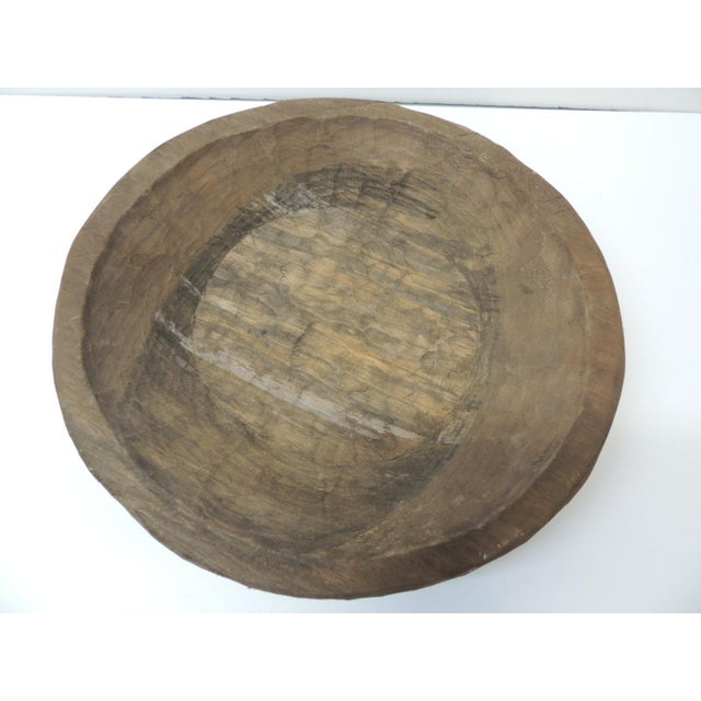 """Mexican round hand carved rustic bowl Size: 16"""" D x 3"""" H."""