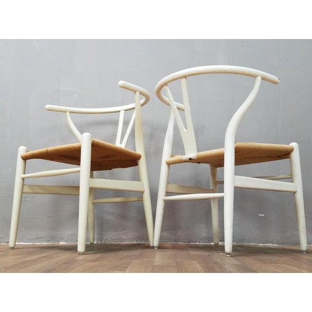 Stunning set of original Hans Wegner wishbone chairs originally from the 1960's. Originally manufactured in solid teak...