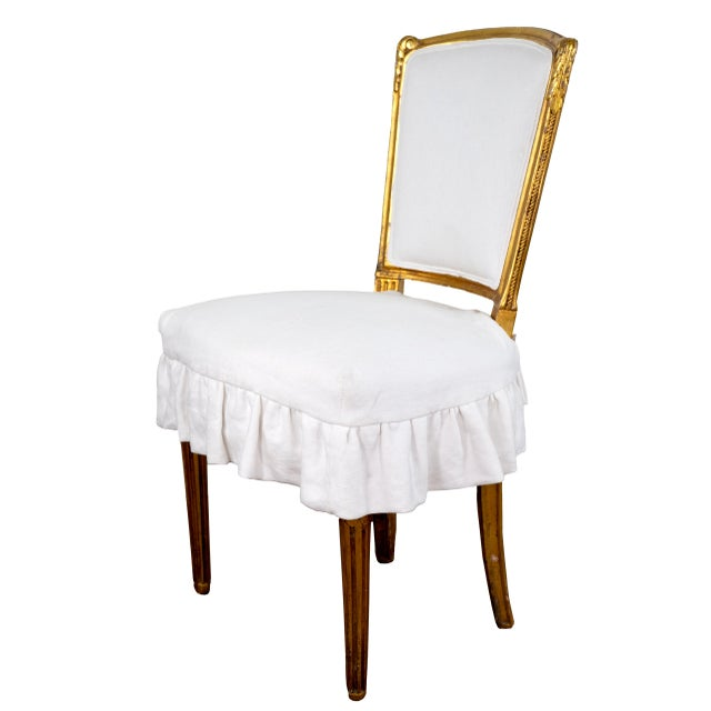 Beautiful pair of french gilded accents chairs with new white linen skirted seats. The gilt has areas of aged patina....