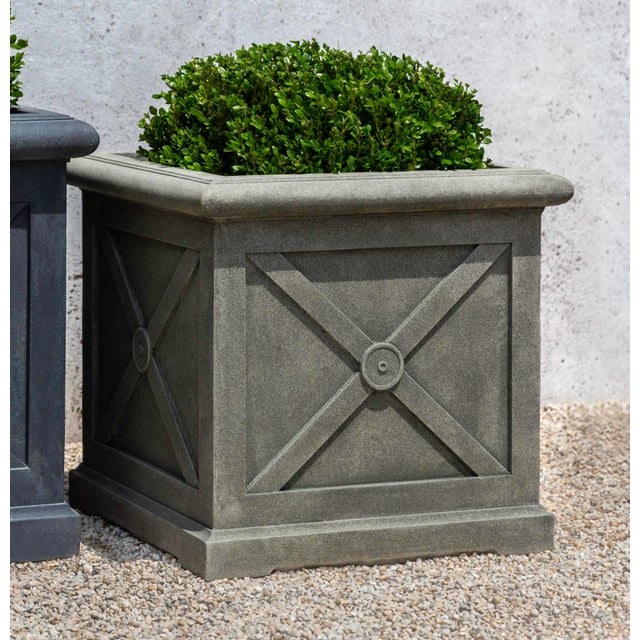 A square planter with a defined rim and cross pattern sides. This listing is for the planter only. No plants are included...