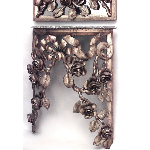 French Victorian gilt carved floral design half round console table with pier mirror.
