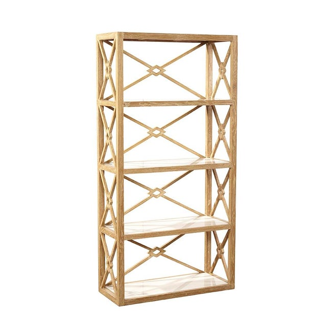Creating clean geometry from simple spare lines of oak, the unique design of this bookcase is pared down to exemplify the...