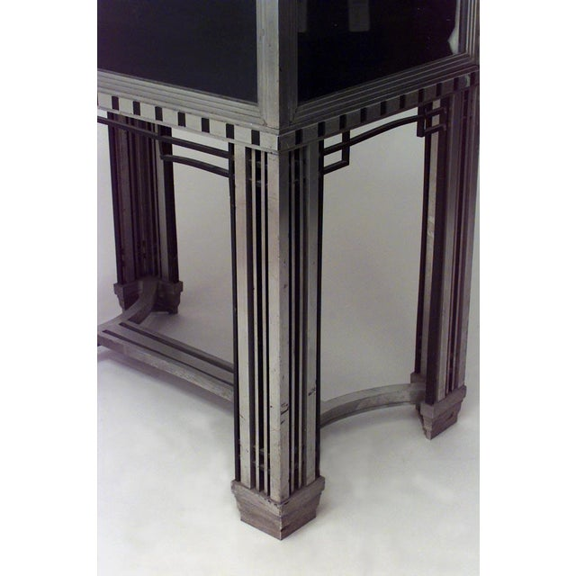 French Art Deco steel and glass vitrine (display) cabinet with 2 shelves (Designed by GEORGE FRYE, executed by JULES BOUVY)