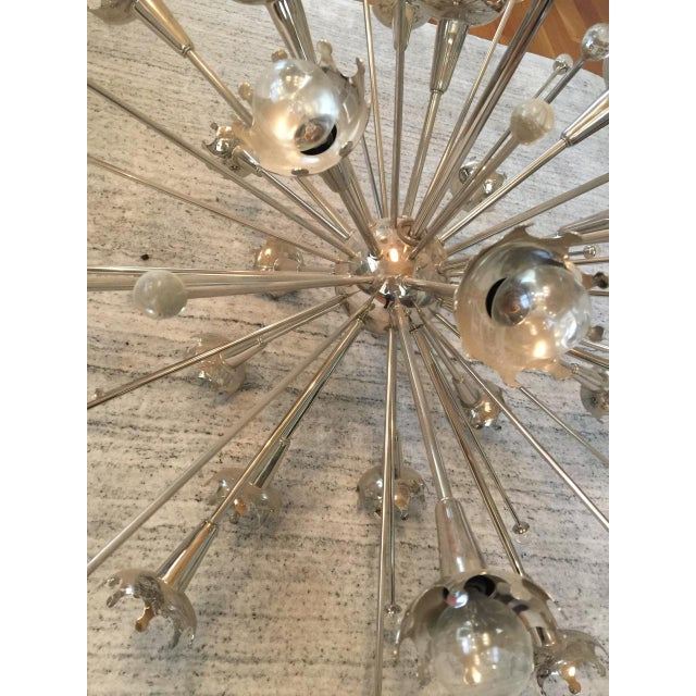 Jonathan Adler Sputnik Chandelier features custom laser-cut crown cups that halo the bulbs for a modern glow. Tiny stems...