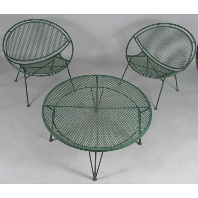 a pair of vintage 1950's wrought iron Radar collection lounge chairs and round companion coffee table designed by Maurizio...