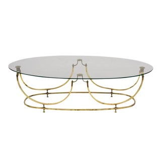 Hollywood Regency Style Brass and Glass Oval Cocktail Table For Sale