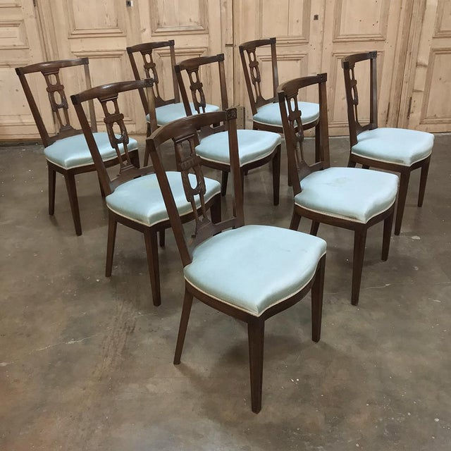 Set of 8 Antique English Hepplewhite Dining Chairs bring classic style to your dining experience, and achieve comfort with...