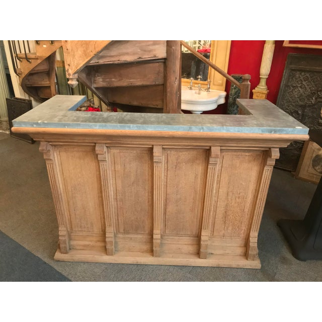 Impeccable bar that hails from a cafe' in Montmartre, Paris 1910. Zinc top, oak base, beautifully carved details. On the...