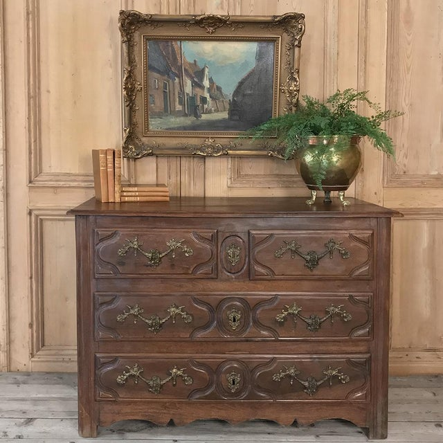 19th Century French Walnut Louis XIV commode is a study in understated elegance! Finely contoured facade defines four...