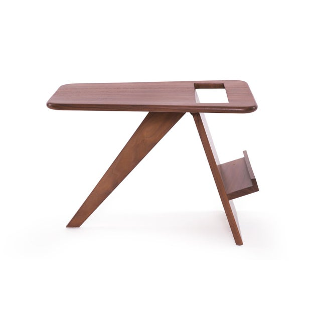 Solid walnut magazine holder circa late 1960's. This example is both functional and sculptural and has been newly and...