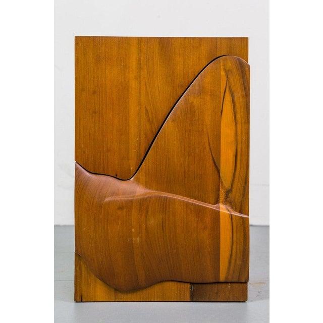 Sculptural freeform cabinet or chest in solid walnut.