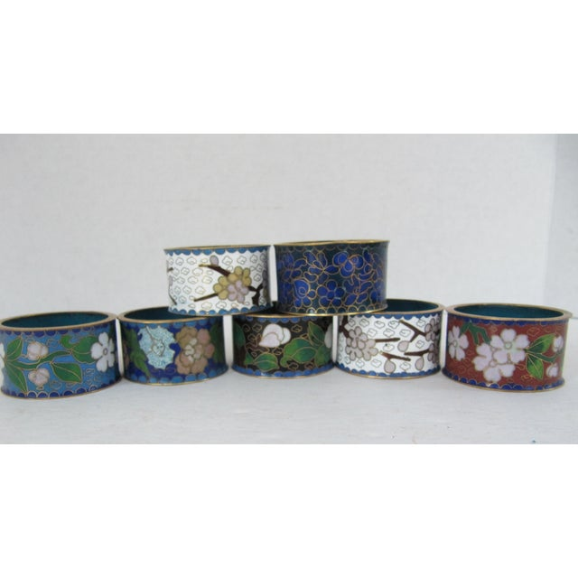 Seven beautiful vintage cloisonné napkin rings in various colors. Great for everyday or a special occasion.
