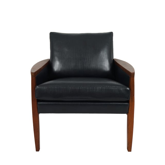 Stunning mid century leather and teak armchair designed by Hans Olsen for Juul-Kristensen. The teak frames have been...