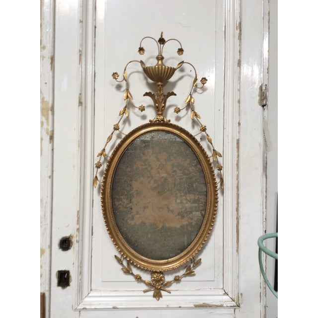 Amazing 18th Century antique giltwood Mirror with oxidized Mirror, ornate carved details in the style of Robert Adams.