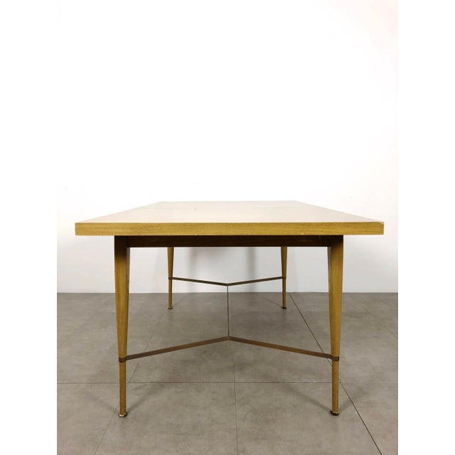 Paul McCobb dining table for the Irwin Collection by Calvin, 1950's. In bleached mahogany with brass stretchers. Includes...