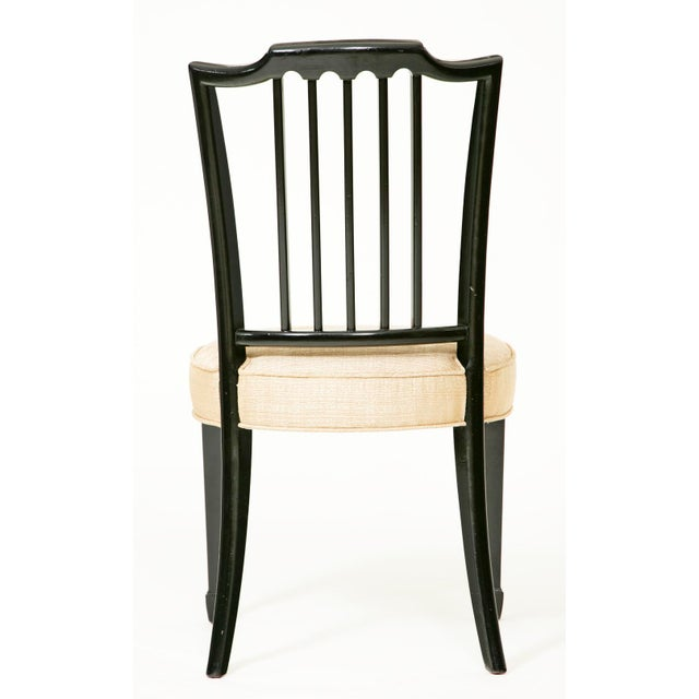 These area a pair of vintage American ebonized side chairs. They are circa 1920 in the Sheraton style. These side chairs...