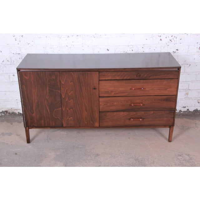 A rare and stunning Perimeter Group credenza by Paul McCobb. The credenza is newly refinished with rich stunning birch...