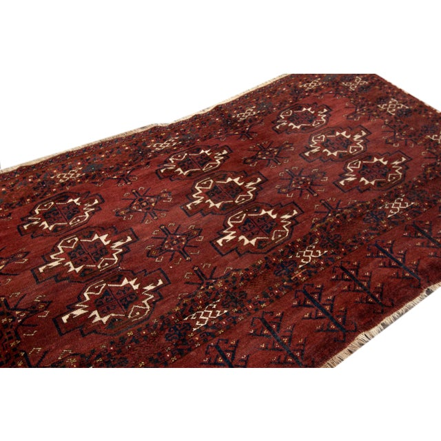 Early 20th Century Antique rug with a red tribal motif. This piece has fine details, great colors, and a beautiful design....