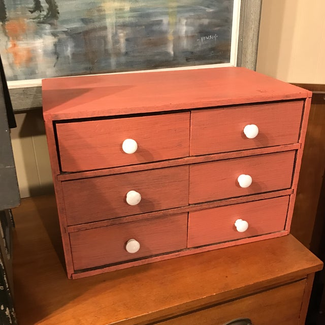 Country American spice chest. Made of wood, painted in salmon color. Minor chipping to the paint.