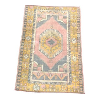 Vintage Faded Turkish Anatolian Faded Pink and Yellow Rug For Sale