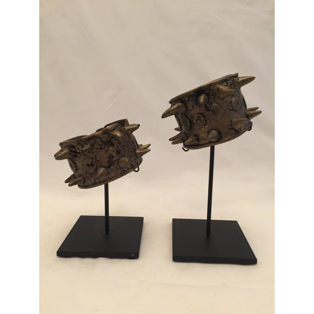 A rare pair of cuffs from the Naga people of North eastern India. These solid brass pieces were worn by high ranking...